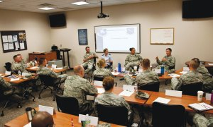 (U.S. Air Force photo by Senior Airman Tiffany DeNault) PETERSON AIR FORCE BASE, Colo. – Peterson and Schriever Air Force Base group commanders talk to students in the superintendent course about the working relationship between the commander, first sergeant and superintendent, June 30, 2015. Senior Master Sgt. Darren Williams, 1st Space Operations Squadron superintendent and Senior Master Sgt. Patricia Ford, 50th Space Control Squadron superintendent, brought the class to Peterson with the intent of teaching senior NCOs how to excel as a superintendent.