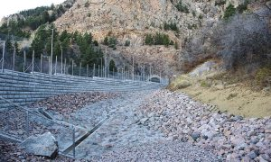 (U.S. Air Force photo by Steve Kotecki) CHEYENNE MOUNTAIN AIR FORCE STATION, Colo. — Cheyenne Mountain Air Force Station completed repairs to the North Portal on Nov. 16, 2016. The project included a 9,300 cubic yard catch basin that will capture overflow mud and small debris away from the road and North Portal.