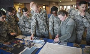 U.S. Air Force photo/Dennis Rogers The time capsule ceremony illustrated the wing's priority of innovating space and cyber systems to stay ahead of the enemy by displaying how the wing has advanced, both technologically and structurally, over time.