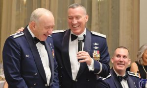 "U.S. Air Force photo/Senior Airman Brandon Files Retired Col. Jack Anthony, 1st Space Operations Squadron commander from July 1996 – July 1998, laughs with Maj. Gen. Burke E. Wilson, Deputy Principal Cyber Advisor to the Secretary of Defense and Senior Military Advisor for Cyber, Office of the Under Secretary of Defense for Policy, Office of the Secretary of Defense, the Pentagon, Washington, D.C. during the squadron's 25th anniversary celebration at The Mining Exchange in Colorado Springs, Colorado, Friday, Jan. 27, 2017. Wilson was the 1 SOPS commander from July 2002 – July 2003. The former commanders recalled their prior service together as ""Captain Wilson"" and ""Major Anthony."""
