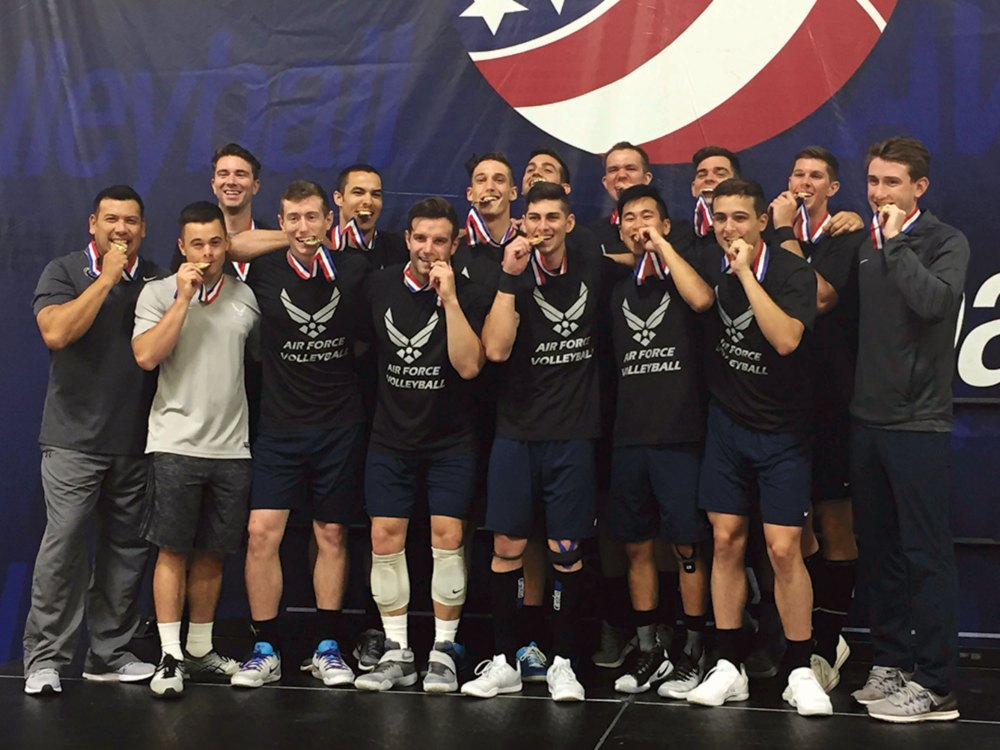 Courtesy photo Capt. Stephen Welling (front row, knee pads on), 50th Operations Support Squadron, and 1st Lieutenant Seth Miller (backrow, second from right), 1st Space Operations Squadron, show off their gold medals with Air Force Volleyball team members after winning the 2017 Armed Forces Tournament in Minneapolis, Minnesota, May 27, 2017. It was the second time in ten years the AFVB earned gold.
