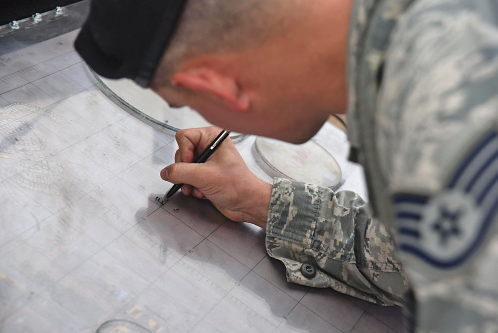 U.S. Air Force photo/Airman 1st Class William Tracy Staff Sgt. Chance Dobbins, 50th Security Forces Squadron Base Defense Operations Center controller, demonstrates plotting a cordon zone on a map at Schriever Air Force Base, Colorado, Monday, Aug. 7, 2017. Implementing cordon zones in reaction to threats is one of many anti-terrorist measures 50 SFS conducts to keep the base safe.