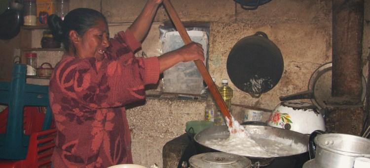 Grandma stirring la masa para tamales, Xela, Guatemala