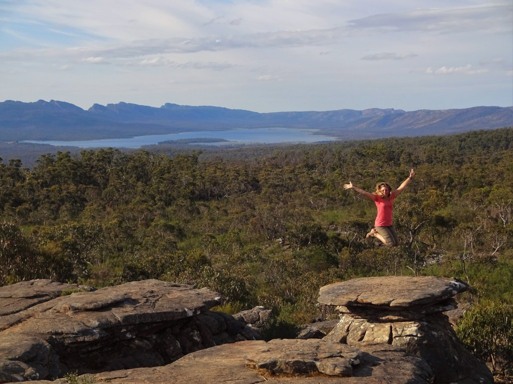 """Jumping for Joy"" on a mushroom-shaped rock at Grampians National Park, Australia"