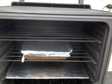 chocolate pudding cake baking in camp oven