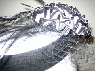 linen feather and french veiling pillbox hat
