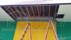 Repairs to an older rolling slat door.