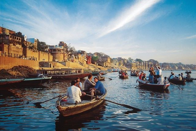 boating, touring around varanasi, india