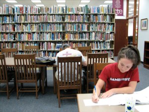 Student studying in a college library