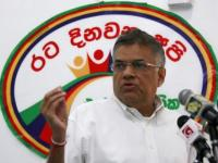 Opposition UNP leader Wickremesinghe gestures during a news conference in Colombo