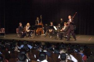Bassoonist Bob Williams talks to students