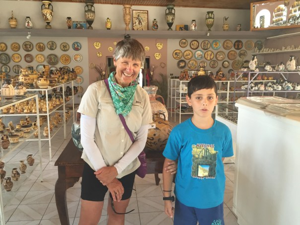 This 10-year boy in Mycene was helping his grandfather see trinkets and teaching me to speak Greek.