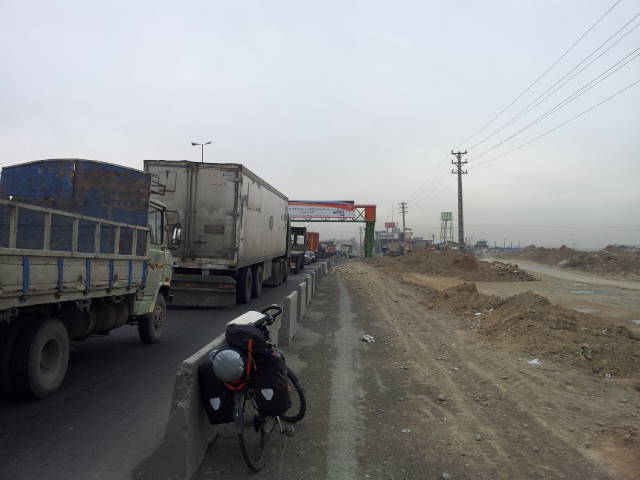 The road out of Tehran - bumper to bumper lorries.