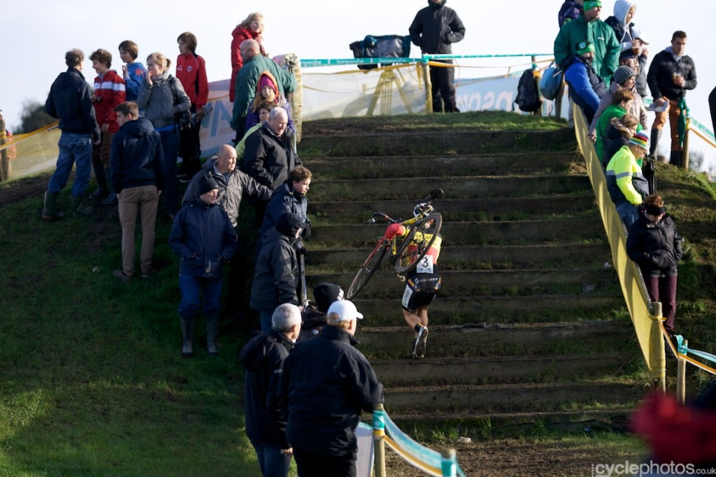 Laurens Sweeck runs up the stairs in the last lap of the U23 cyclocross Superprestige race in Ruddervorde.