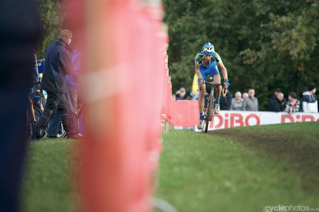 Thijs van Amerongen rides past the technical zone in the penultimate lap of the elite men's cyclocross World Cup race in Valkenburg