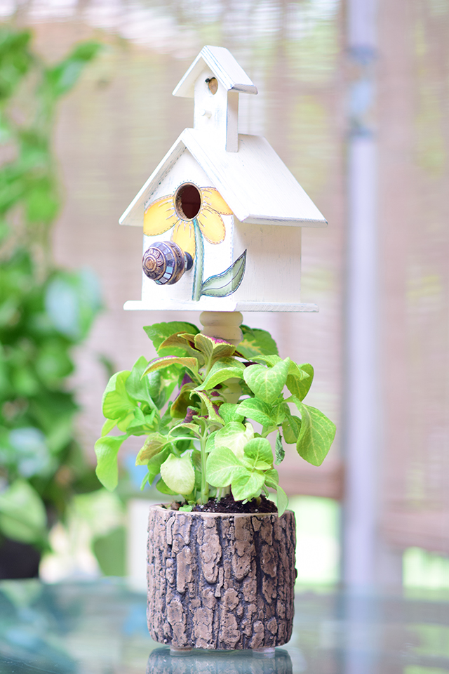 Tree trunk birdhouse planter
