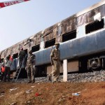 Train rams school bus in southern India, kills 13
