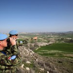 UNFICYP soldier scans the buffer zone
