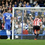 Sunderland's Fabio Borini (L) scores the winning goal from the penalty spot against Chelsea
