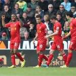 Liverpool's Raheem Sterling (2nd L) celebrates scoring his second and his teams third goal