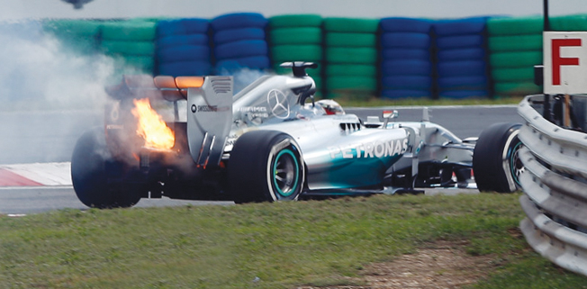 Rosberg on pole, Hamilton's hopes go up in flames
