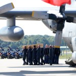 Dutch mourn as first MH17 bodies arrive in Netherlands