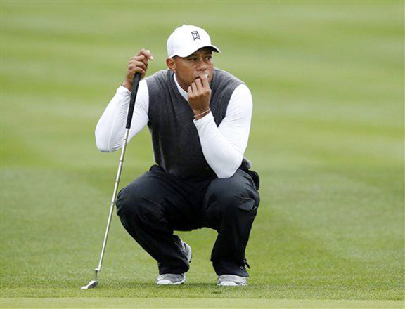 Woods slumps to worst round as a professional