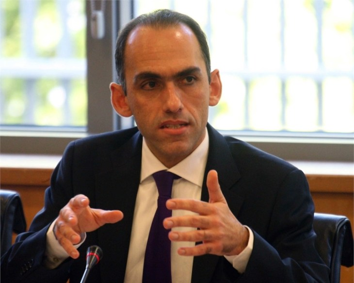 Bailed-out Cyprus eyes return to normal borrowing this year