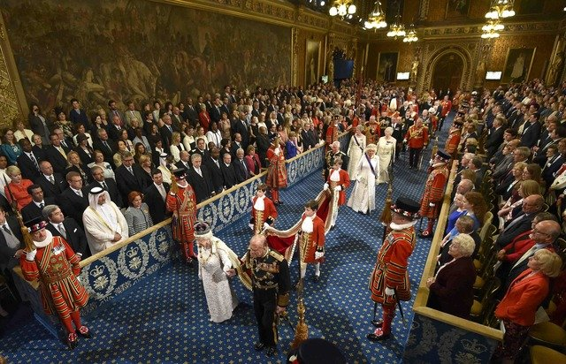 Britain's Queen Elizabeth and Prince Philip proceed through the Royal Gallery before the State Opening of Parliament in the House of Lords, at the Palace of Westminster in London