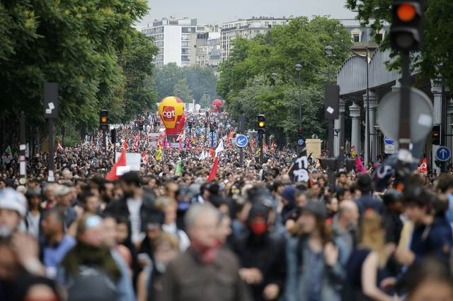 French labour unions workers attend a demonstration against plans to reform French labour laws in Paris