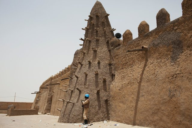 A UN peacekeeper stands guard at the Djinguereber mosque during a visit by a UN delegation on election day in Timbuktu