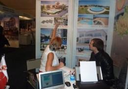 Burcu talking to prospective clients