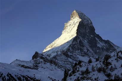 The rising sun illuminates the Matterhorn mountain, seen from ...