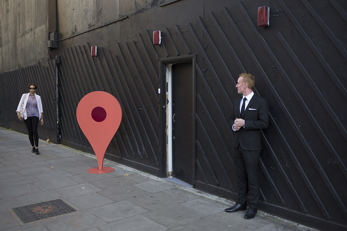 Thousands of fake companies added to Google Maps every month   New     Boarded up street frontage with a physical recreation of a Google Maps pin  in front of