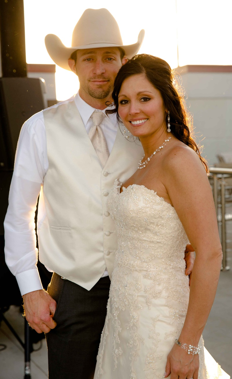 country bride groom in ivory country themed wedding dresses Shelly Bartels in Maggie Sottero wedding dress and Tyrel Nelson in white wedding attire