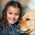 small girl with dog