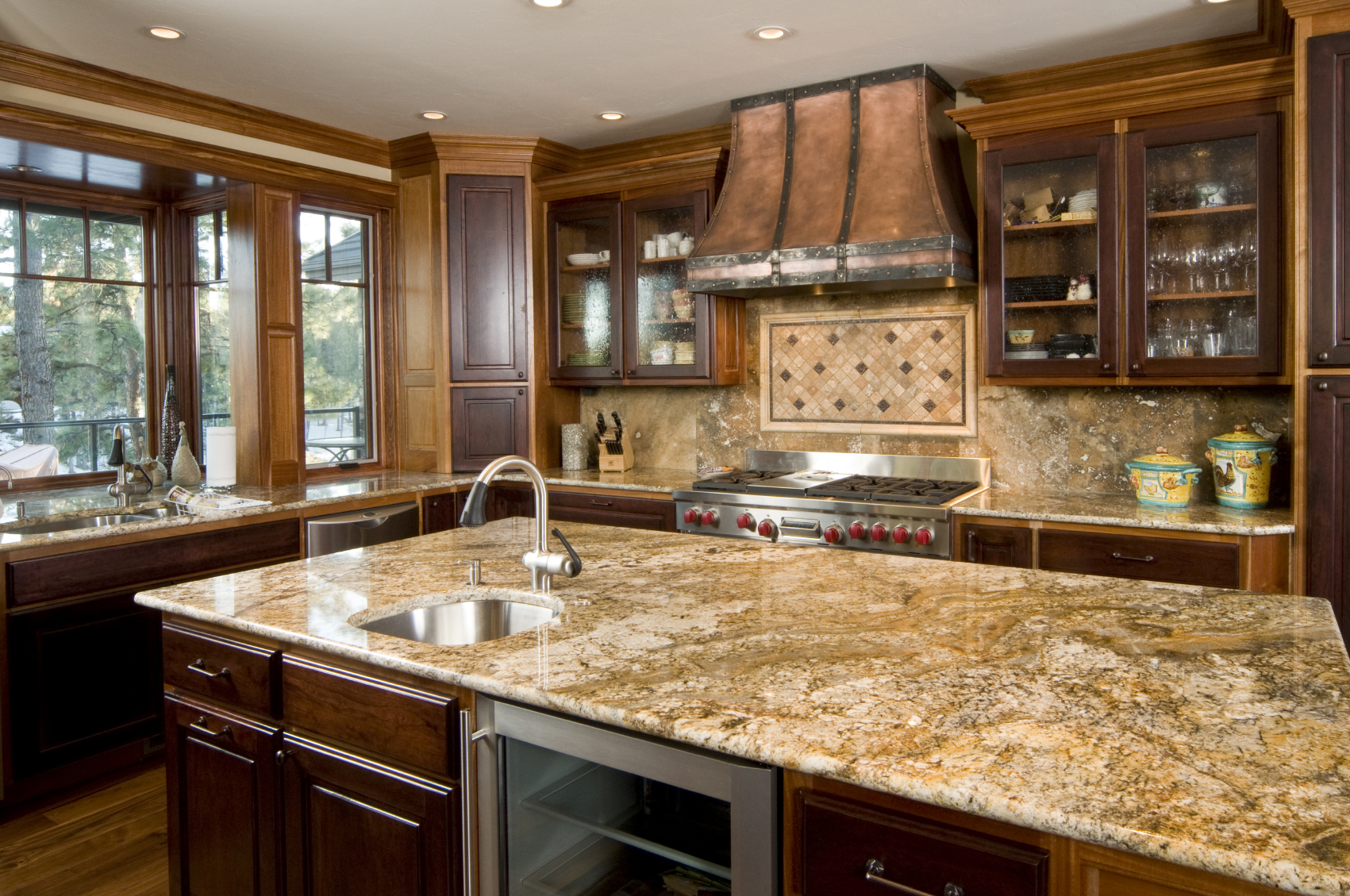 contemporary wood kitchens wooden kitchen countertops Copper tones unify this kitchen featuring dark wood cupboard doors over lighter toned cabinetry with