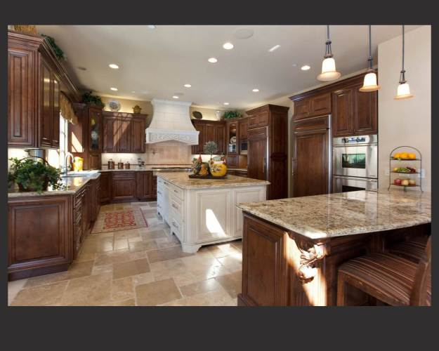 40 magnificent kitchen designs with dark cabinets wood floor in kitchen Richly detailed U shaped kitchen centers dark wood cabinetry around large white painted wood