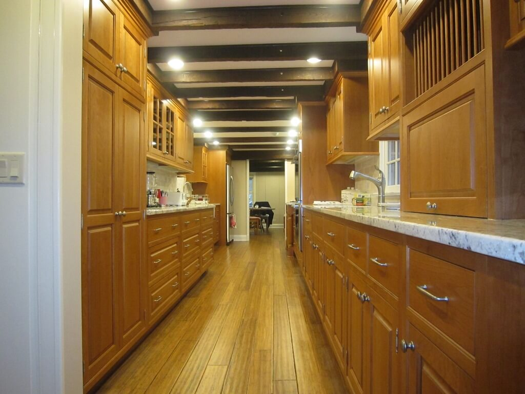 galley kitchen design ideas galley kitchen ideas Light wood toned galley kitchen with nearly matching floor