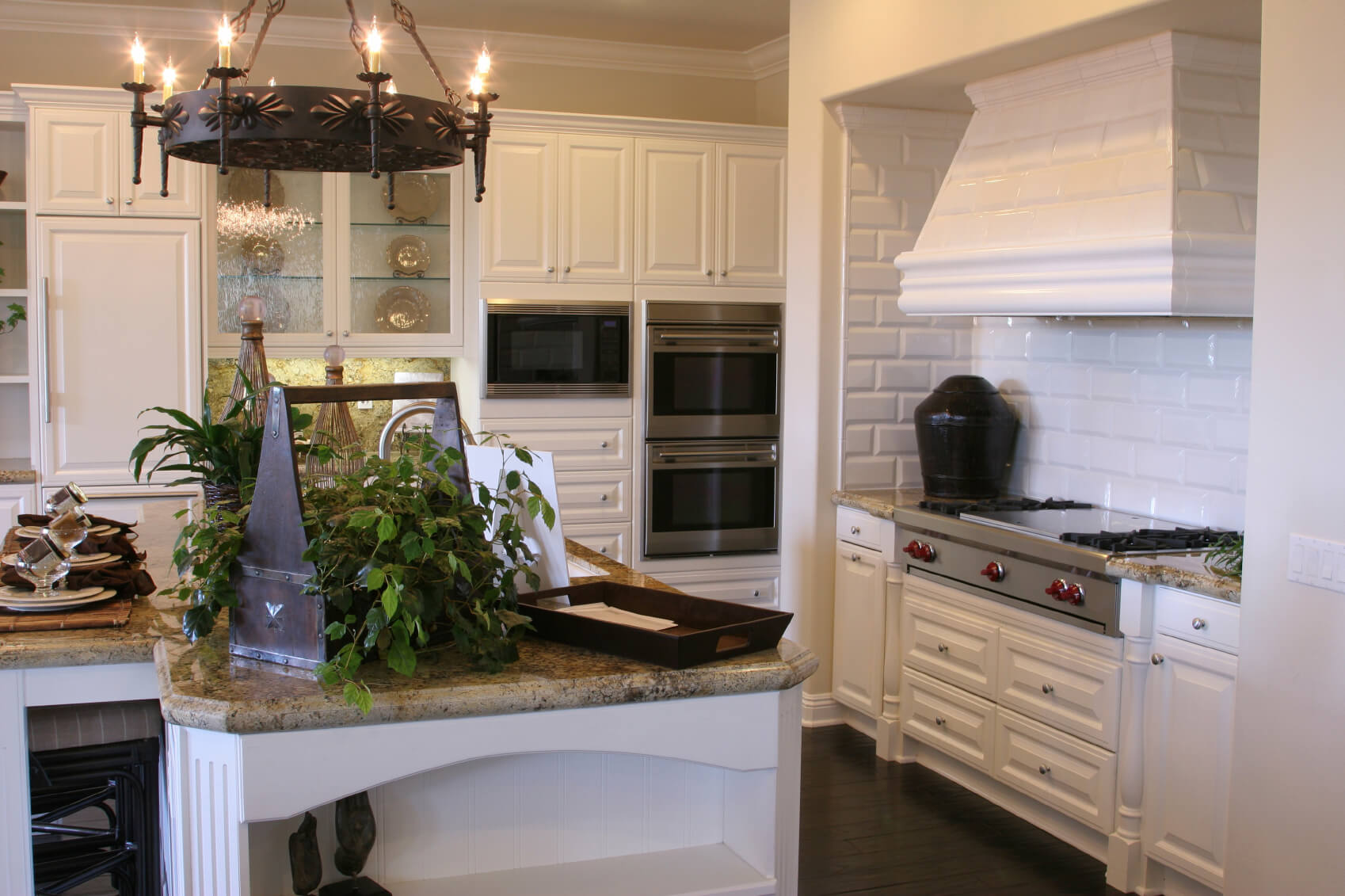 dream kitchen designs white kitchen dark floors Kitchen featuring contrast of bright white cabinetry and tile backsplash with dark wood flooring and