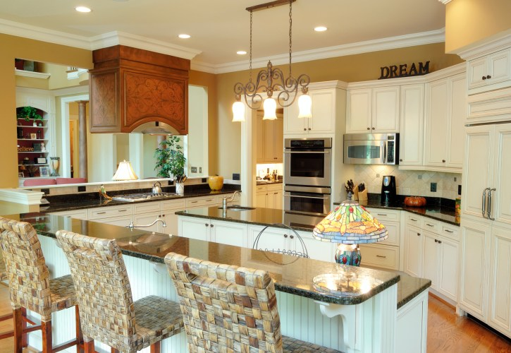 white kitchen designs pictures kitchen white cabinets Spacious country kitchen with white cabinetry throughout with mustard yellow walls