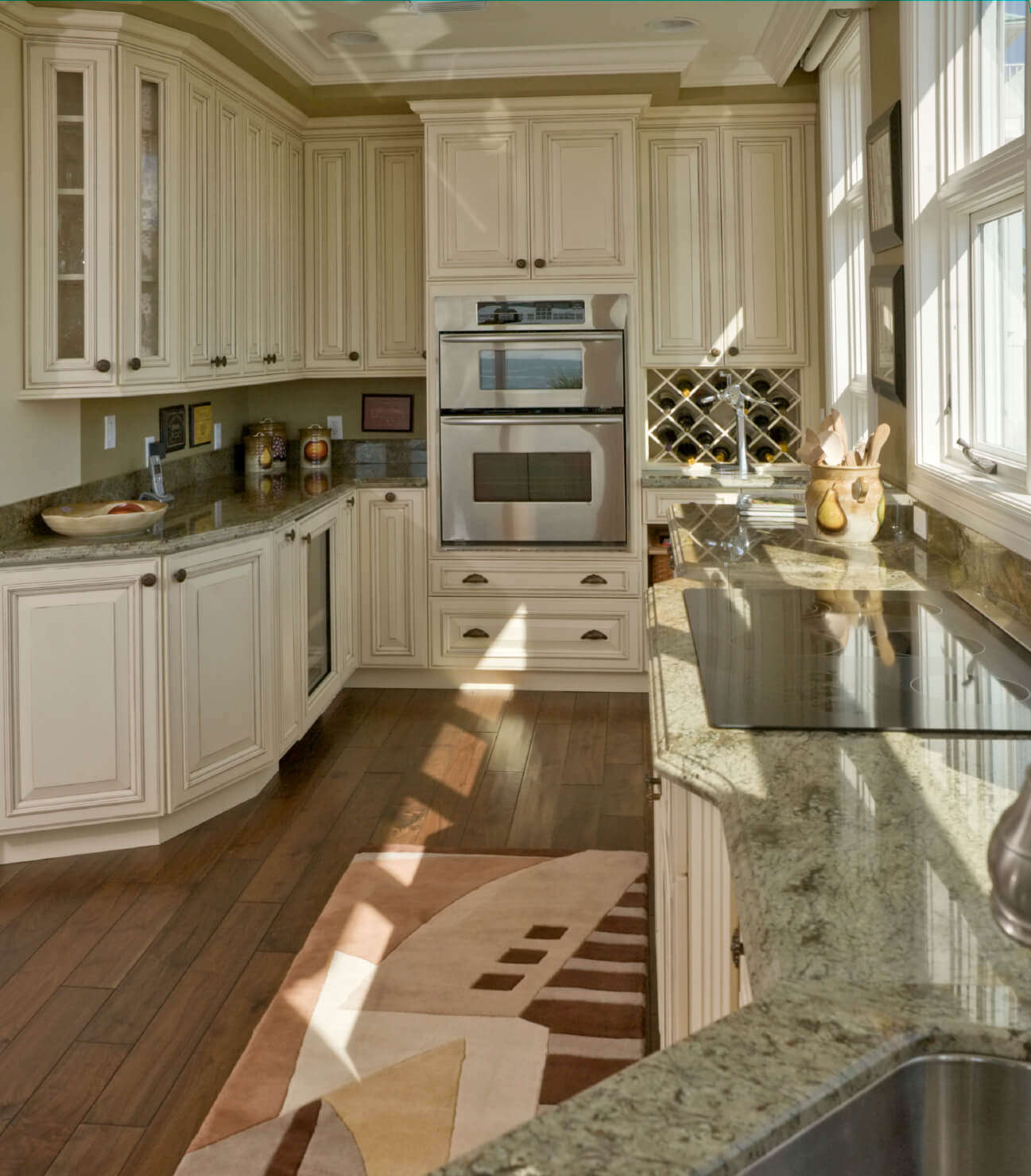 white kitchen designs pictures cheap kitchen flooring Treated white cabinets add to the old fashioned look in this compact kitchen featuring geometric rug