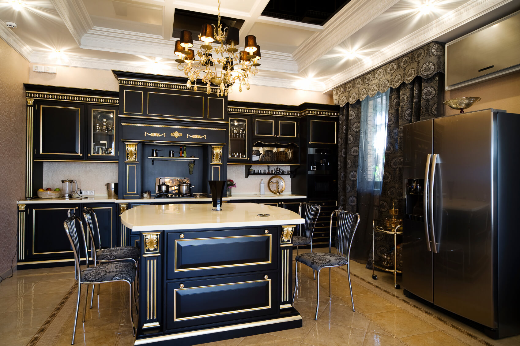 dark kitchen cabinets kitchen counters and backsplash Ultra luxurious kitchen features gilded black wood cabinetry over beige marble flooring White marble countertops