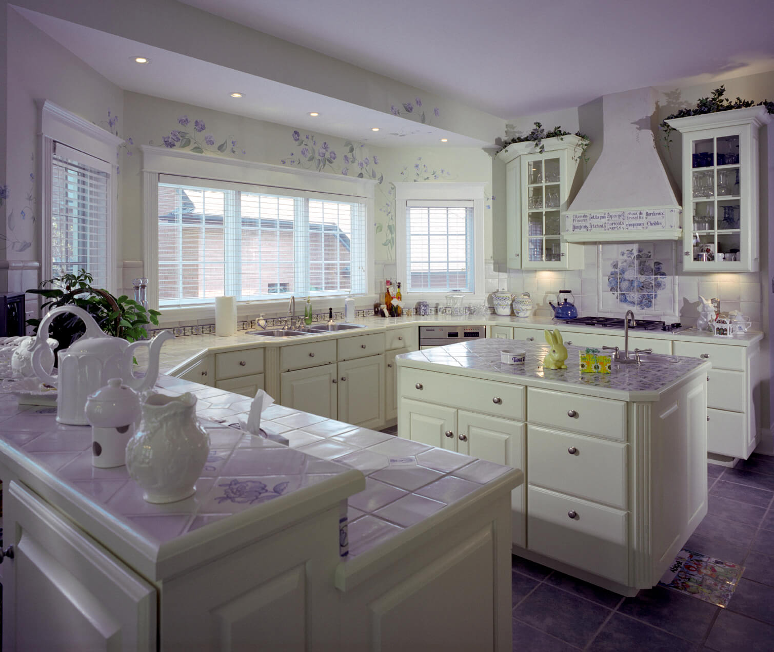 white kitchen designs pictures kitchen white cabinets This white kitchen is enlivened by a smattering of purple throughout purple tile flooring