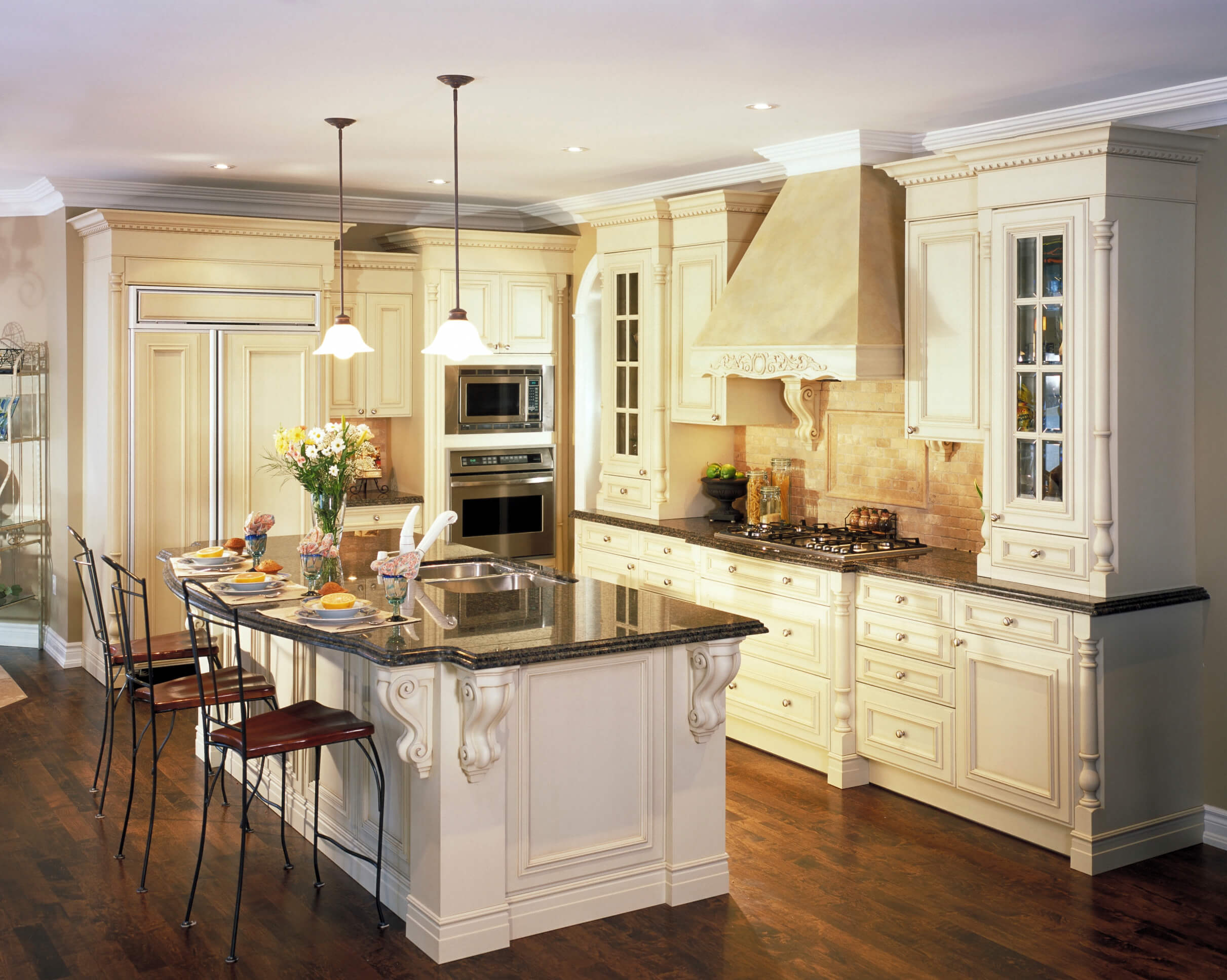 dream kitchen designs glass kitchen countertops Kitchen featuring great contrast between dark wood flooring white cabinetry and black marble countertops