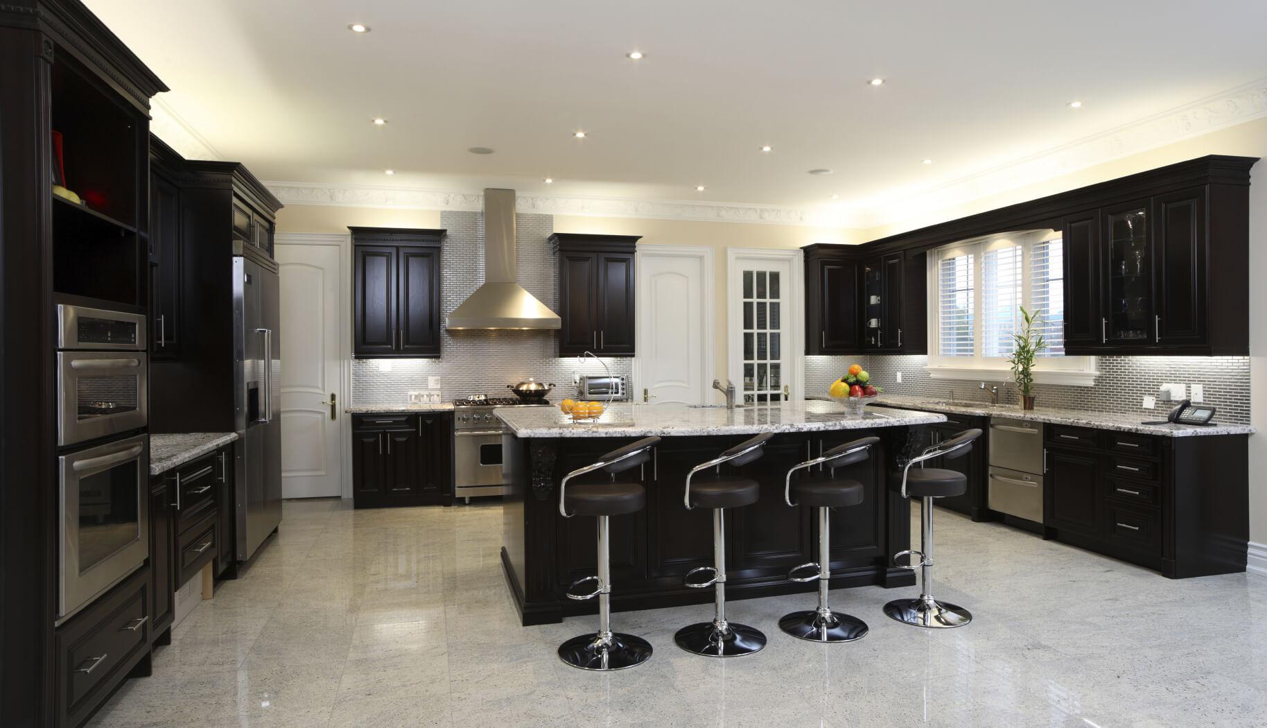 dark kitchen cabinets black kitchen countertops Spacious modern kitchen with dark cabinetry breakfast bar 4 modern diner style stools and
