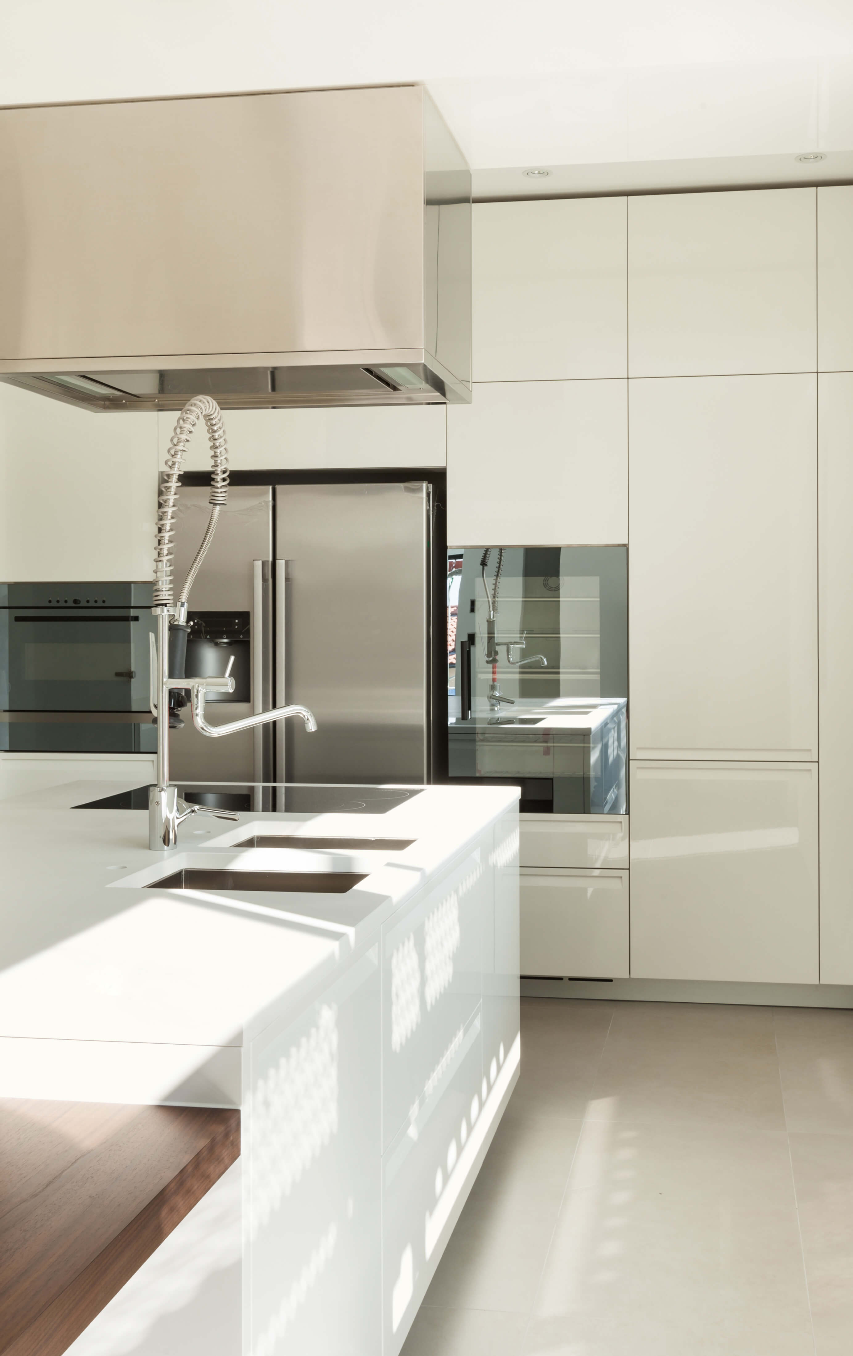 white kitchen designs pictures white kitchen table Ultra modern slick surfaces abound in this kitchen featuring glossy white cabinetry and countertops over