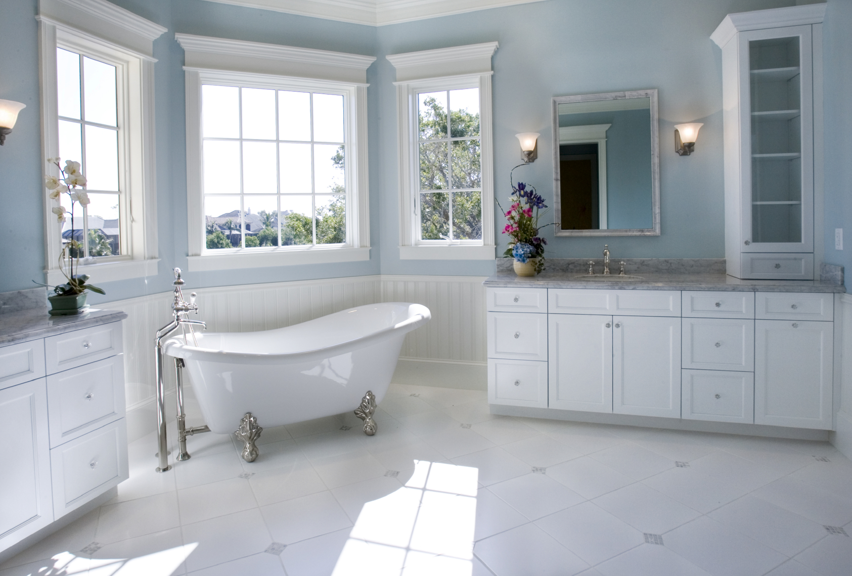 luxury white bathroom designs kitchen and bath design Soft sky blue walls float above the white cabinetry and marble flooring in this bathroom