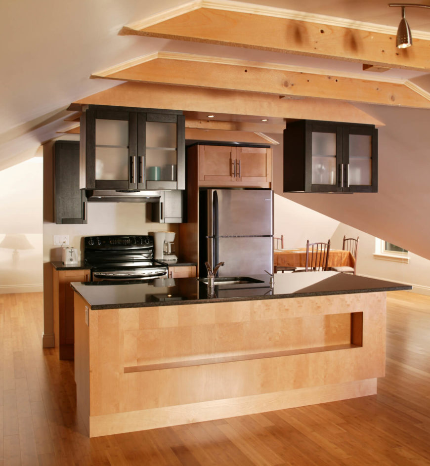 small kitchen designs with islands small kitchen islands A small kitchen situated against a half wall in the center of the open