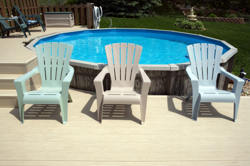 This Round Aboveground Pool Is Surrounded By A Multi Leveled Deck That A